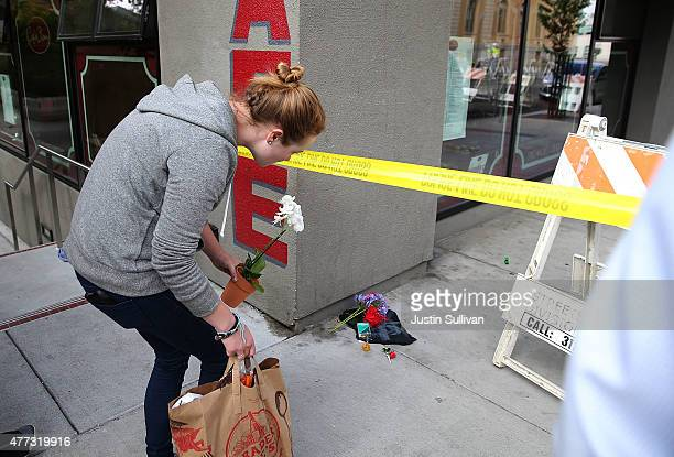 A woman drops off flowers at the scene of a balcony collapse at an apartment building near UC Berkeley on June 16 2015 in Berkeley California 5...