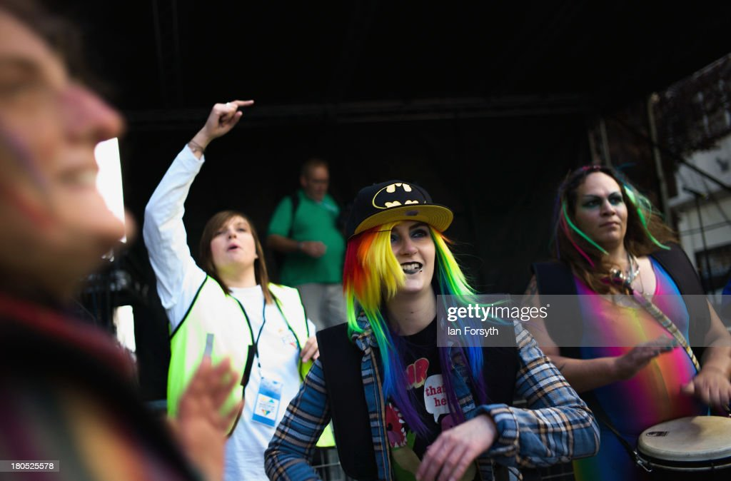 Woman drummers perform for the crowd as they takes part in a parade during a Community Pride event on September 14, 2013 in Middlesbrough, England. The parade was the culmination of a three day event to raise awareness and celebrate Lesbian, Gay, Bi-sexual and Transgender life.