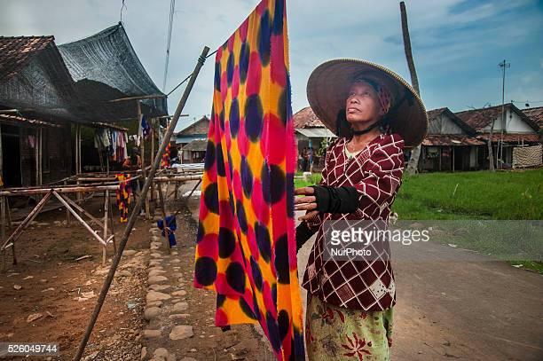 A woman dry in the sun as making Batik Santung in Village Jeruksari Pekalongan Central Java Indonesia on February 22 2016This process of making Batik...