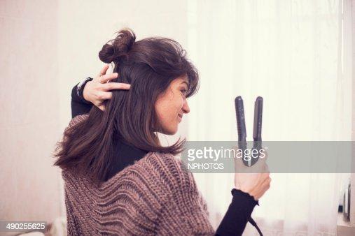 Woman drying hair