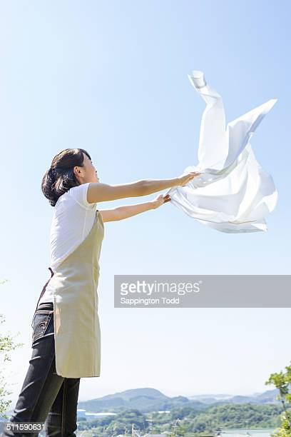 Woman Drying White Shirt