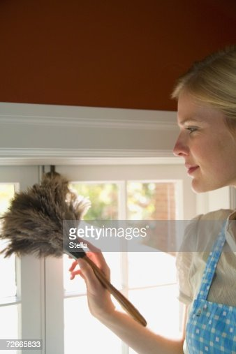 Woman dusting in home