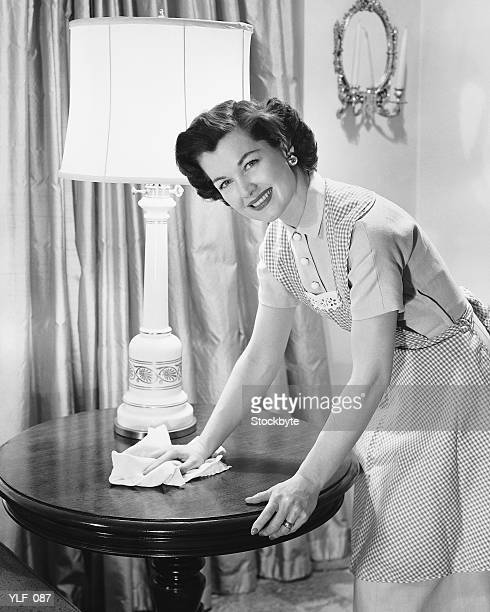 Woman dusting table