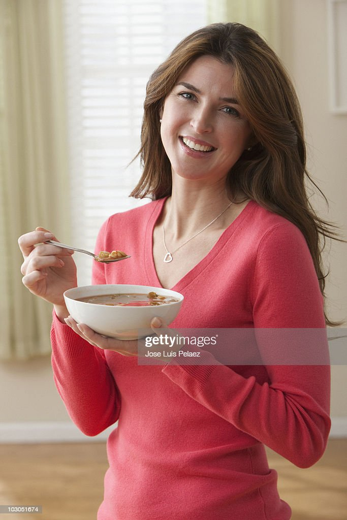 Woman eating a bowl of soup