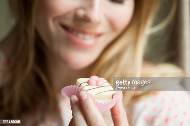 Woman eating a cupcake