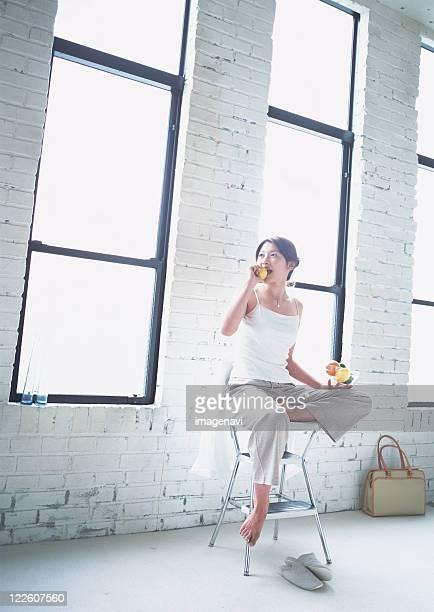 Woman eating a lemon