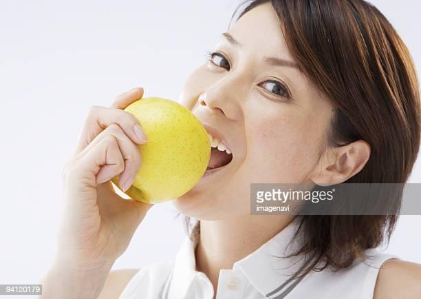 A woman eating an apple