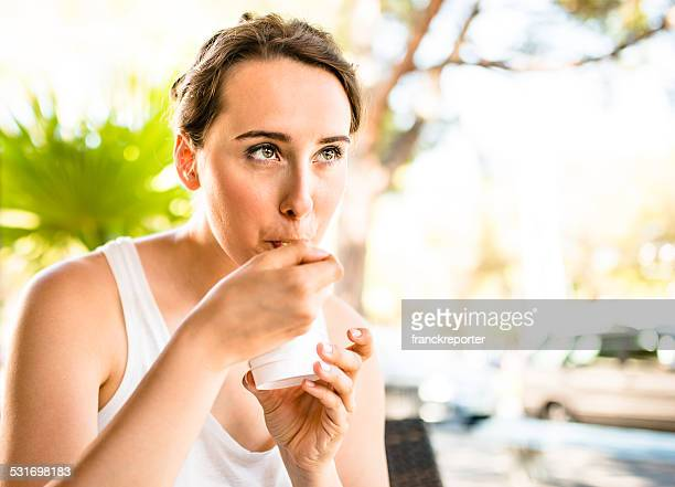 woman eating an icecream on summer