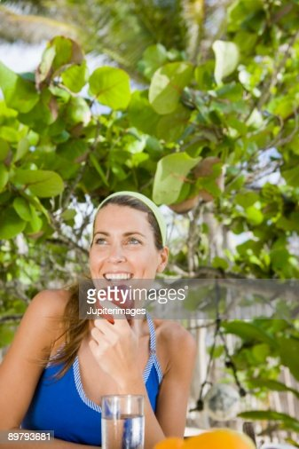 Woman eating apple outdoors : Stock Photo
