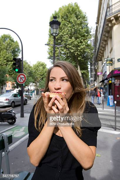 Woman eating at street