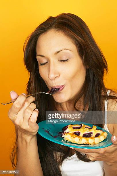 Woman Eating Blueberry Pie