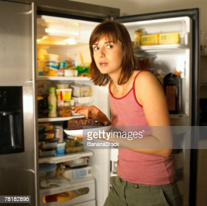 Woman eating cake : Stock-Foto