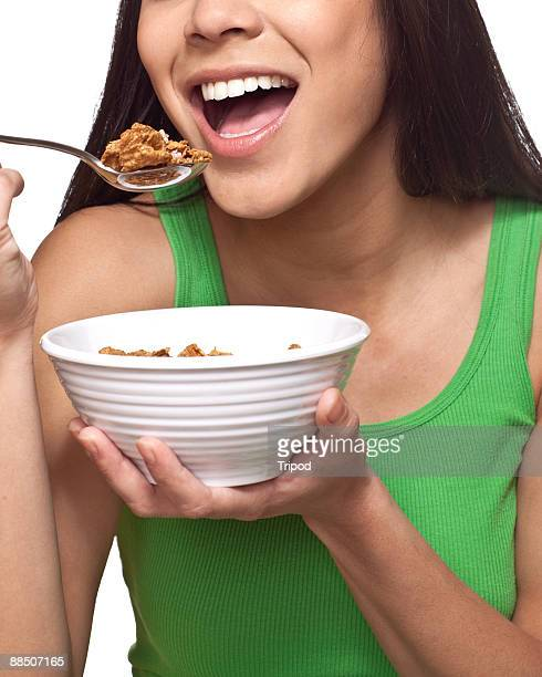 Woman eating cereal, close-up