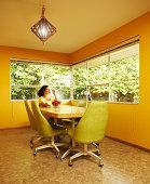 Woman eating cherries in dining room