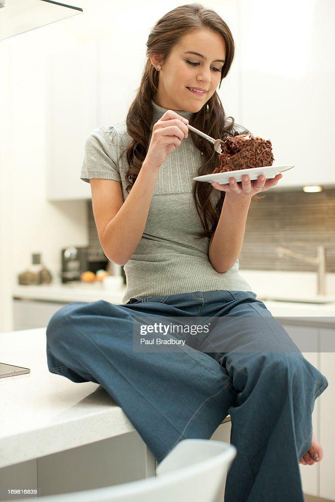 Woman eating chocolate cake : Stock Photo