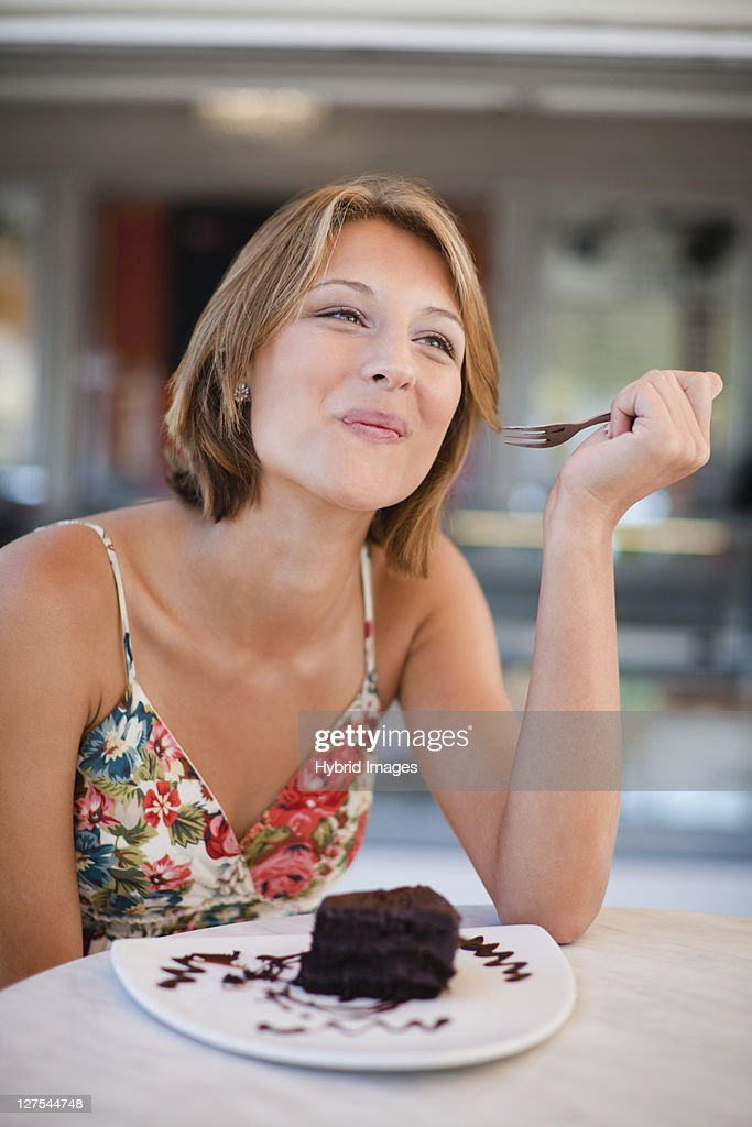 Woman eating dessert at cafe : Stock Photo