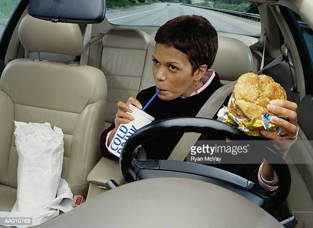 Woman Eating Fast Food While Driving