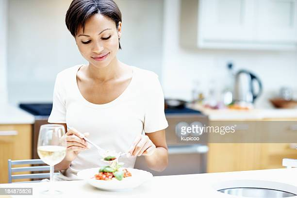 Woman eating food at home