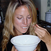 Woman eating from a bowl