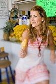 Woman eating fruit dessert at tropical bar