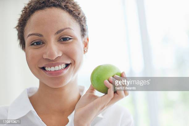 Woman eating green apple