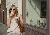 Woman eating in street