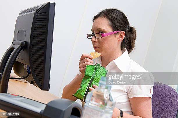Woman eating lunch at work