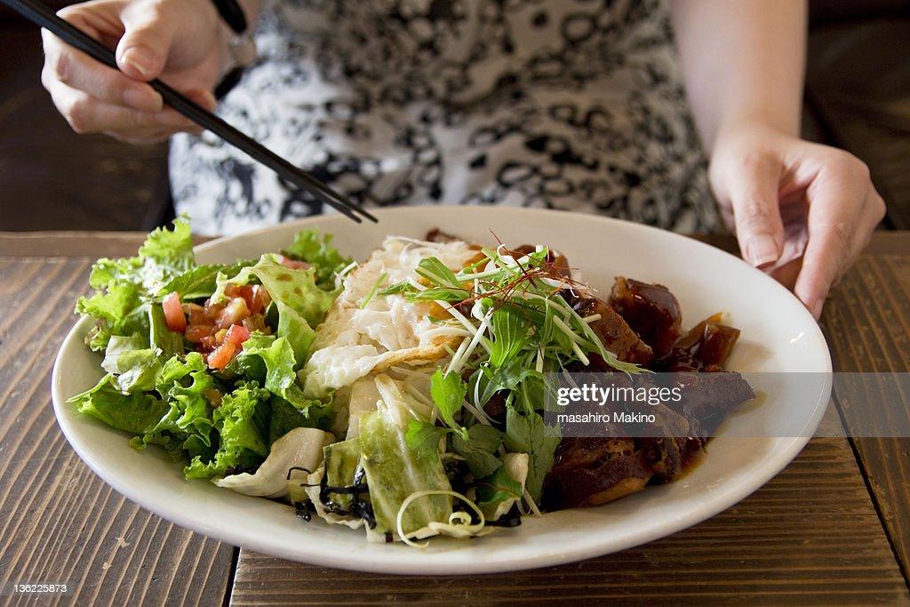 Woman eating lurou fan