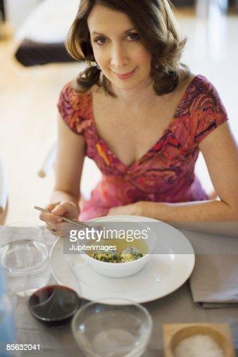 Woman eating matzoh ball soup : Stock Photo