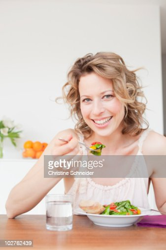 Woman eating green salad Stock photo and royaltyfree