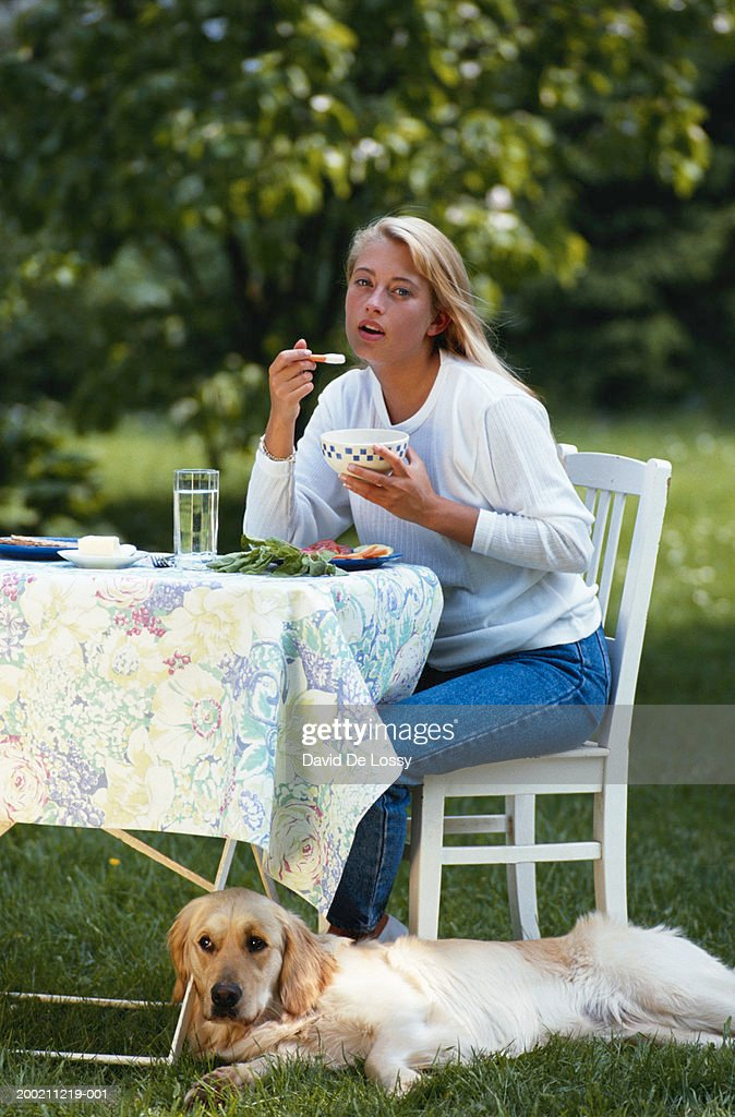 Woman eating : Stock Photo
