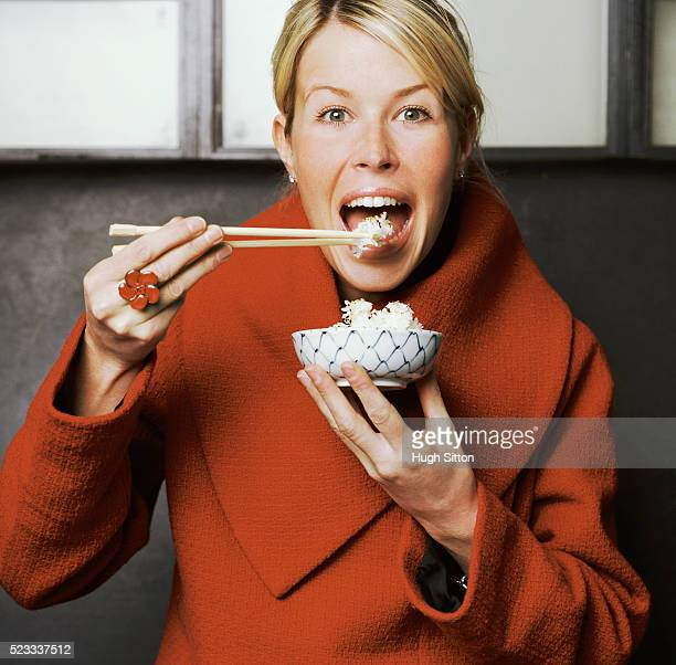 Woman Eating Rice