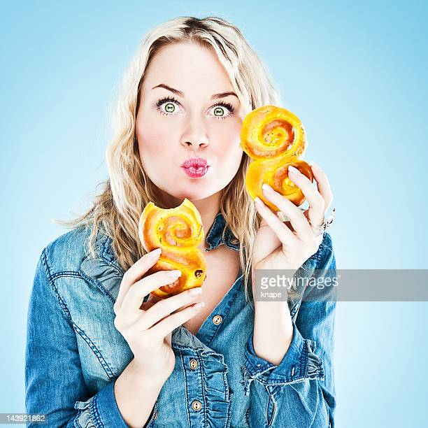 Woman eating saffron buns