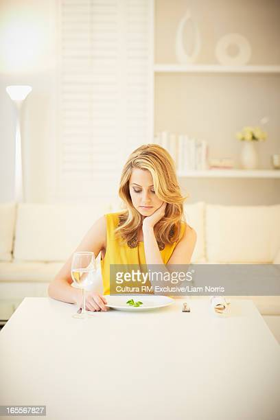 Woman eating small lunch