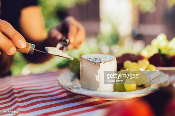 Woman eating soft cheese.