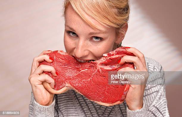 Woman eating steak
