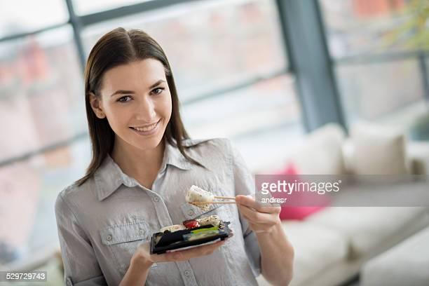 Woman eating sushi