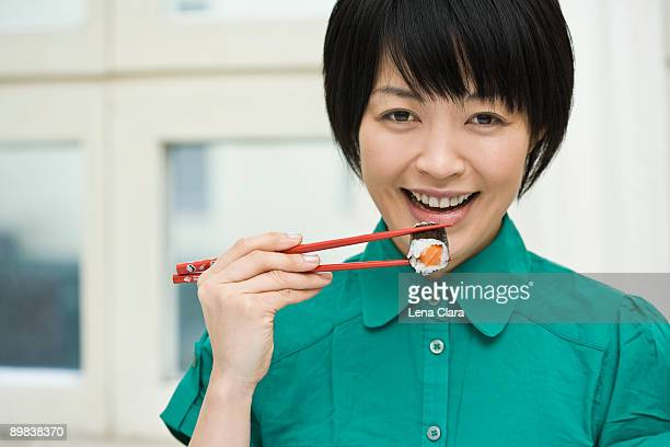 A woman eating sushi