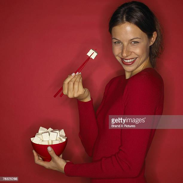 Woman eating tofu