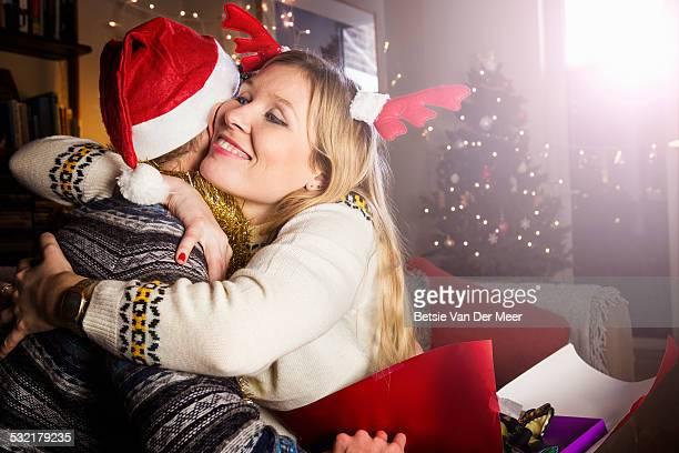 Woman embracing man at Christmas.