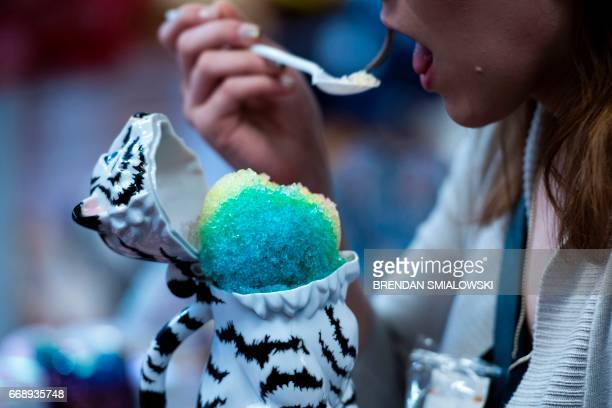 A woman emjoys shaved ice during a showing of the Ringling Brothers and Barnum Bailey Circus at Eagle Bank Arena April 14 2017 in Fairfax Virginia...