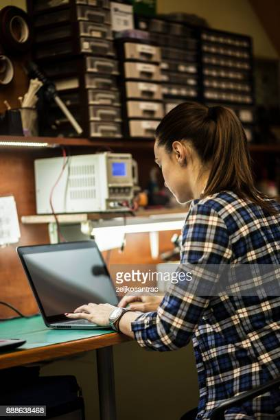 Woman engineer working on a laptop