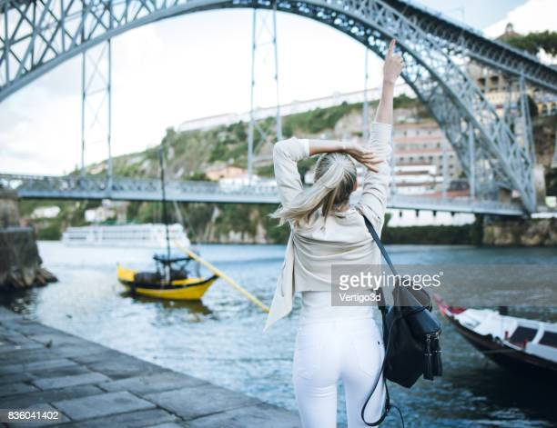 Woman enjoy freedom traveling and open her arms for embrace the city