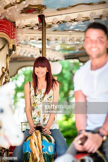 Woman enjoy on the carousel