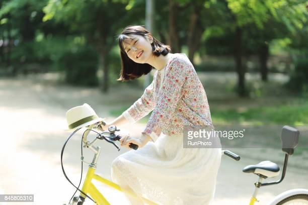 Woman enjoying a bicycle for two people