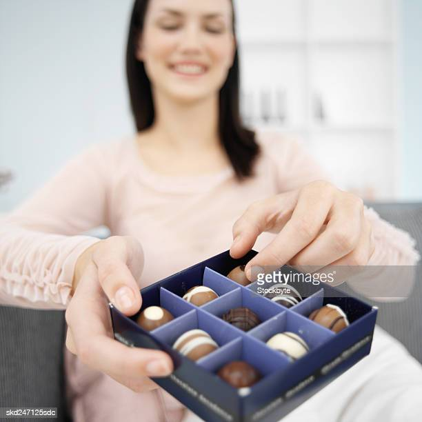 Woman enjoying a box of chocolates