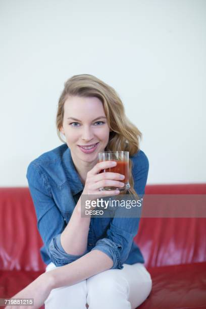 Woman enjoying a drink on the couch