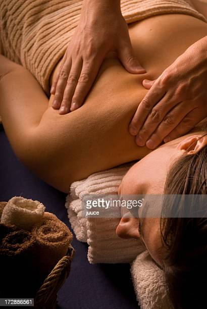 A woman enjoying a massage at the day spa
