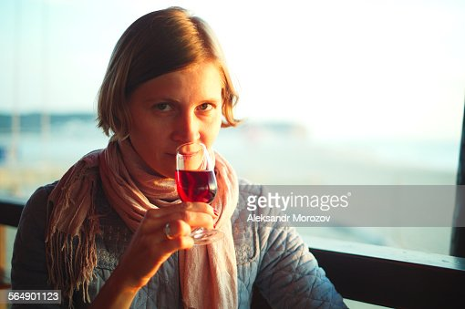 Woman enjoying a portwine
