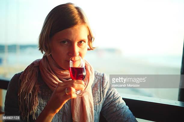 Woman enjoying a portwine